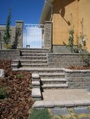 Retaining wall stairs and planters
