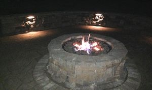 Gas firepit, paving stones, and landscape lighting