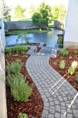 Paving stone patio, retaining walls and stairs, planting