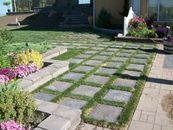 Paving stone slabs with grass between