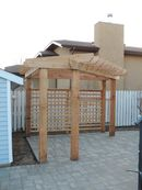 Cedar pergola with paving stone patio