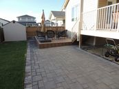 Paving stone patio and composite deck