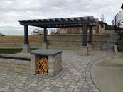 Paving stone patio, pergola, retaining walls and stairs
