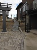 Paving stone patio, retaining walls and stairs