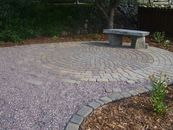 Paving stone patio with bench