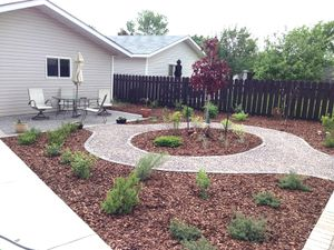 Planting, path, and paving stone patio