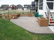 Paving stone patio, composite planters and benches