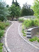 Gravel path, retaining walls, planting